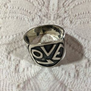 Vintage sterling silver LOVE ring peace signs